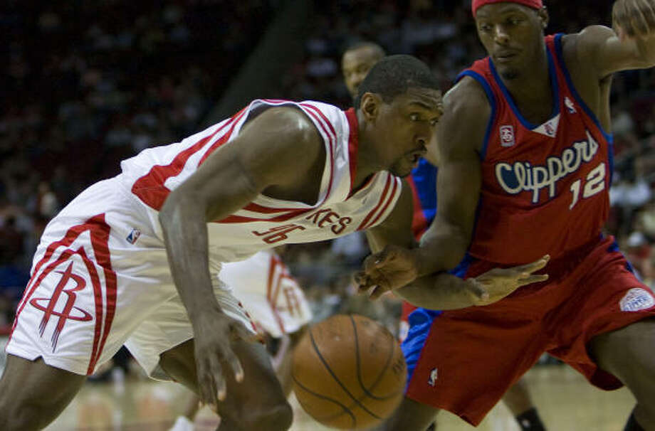 Ron Artest will join Tracy McGrady on the bench for the next week and perhaps beyond that. Photo: James Nielsen, Houston Chronicle