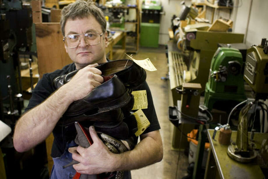 MORE FIXING, LESS SELLING: Barry Croft says shoe and purse repairs are up as much as 30 percent over last year at his store in the West University area. Photo: Eric Kayne, Chronicle