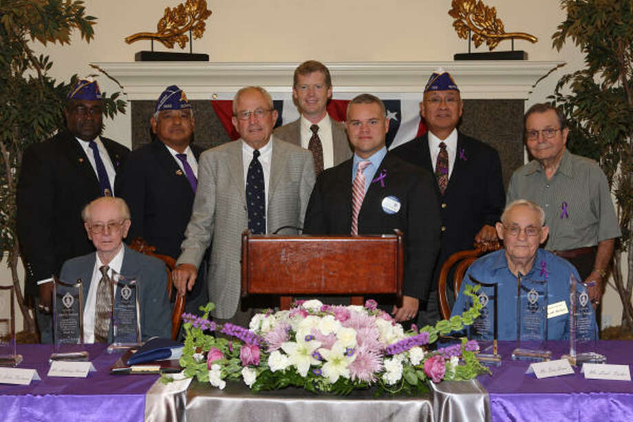 PURPLE HEARTS HONORED: Cypress Woods retirement community hosted a National Purple Heart Recipient Recognition Day in Kingwood. The veterans were honored by Texas congressman Joe Crabb and Cypress Woods representative Michael-David Reilly. In the photo are, sitting, Ray Allen and Loal Tucker. Standing, John D. Footman, Anthony Roman, Congressman Crabb, Mike Bardelmeier and Reilly from Cypress Woods, Sam Luna and J.C. Weisinger. Photo: By Pat And Ray's Studio, For The Chronicle