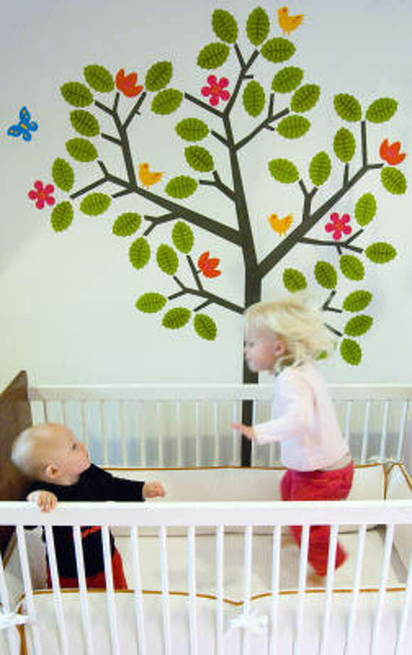 Season Tree wall sticker from WallNutz.com is $54. The pieces can be arranged as a single 65-inch-high tree or two 45-inch trees. Photo: Wallnutz.com