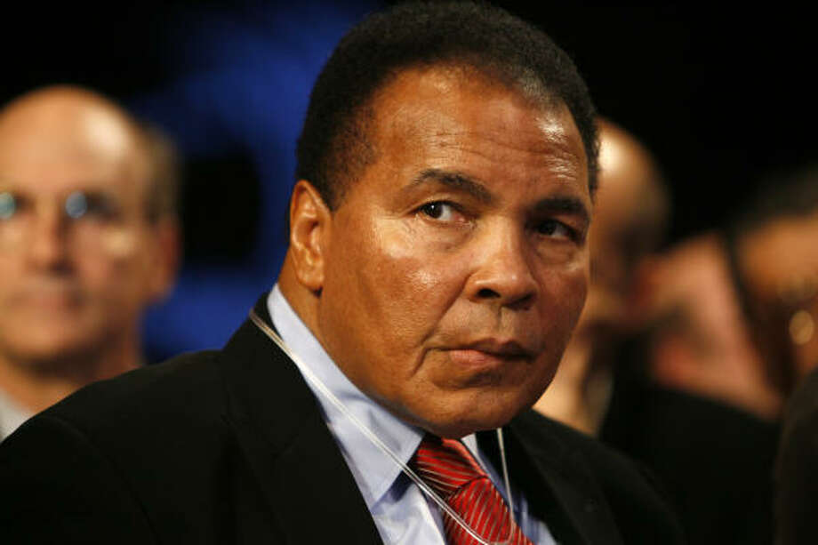 """Boxing legend Muhammad Ali will be part of the party when Barack Obama is inaugurated as the nation's first black president on Tuesday.  """"The Greatest"""" is scheduled to be an honored guest at today's Bluegrass Ball, a celebration sponsored by the Kentucky Society of Washington. Photo: Jason DeCrow, AP"""