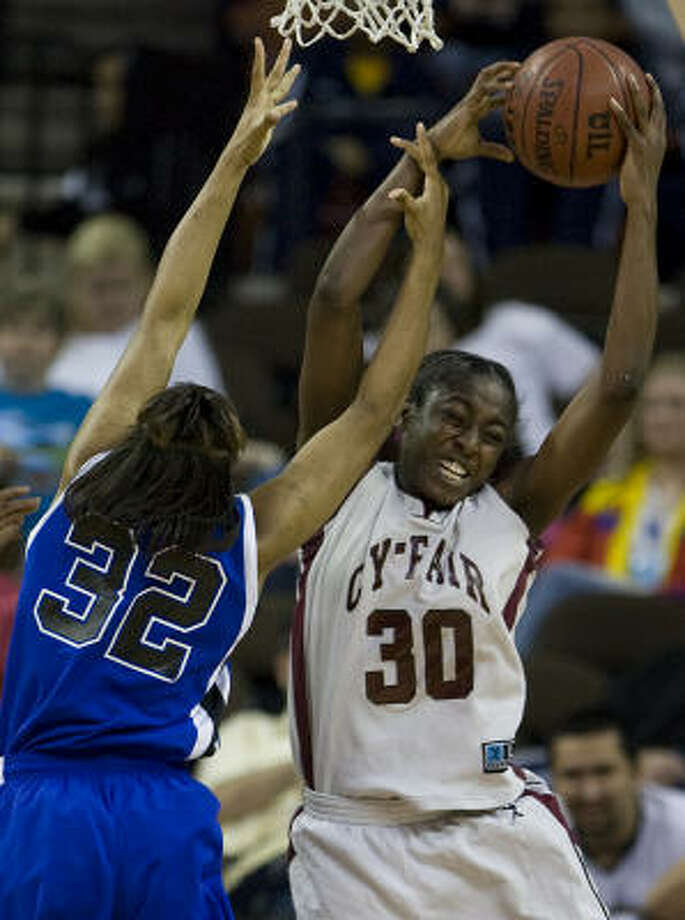 Cy-Fair's Chiney Ogwumike (30) wrestles a rebound away from Mansfield Summit's Breanna Harris (32) during the second half of the Bobcats' 49-39 loss in the UIL girls class 5A state high basketball tournament semifinals at the Frank Erwin Center Friday in Austin. Ogwumike scored 30 points for the defending champions in the loss. Photo: Smiley N. Pool, Houston Chronicle