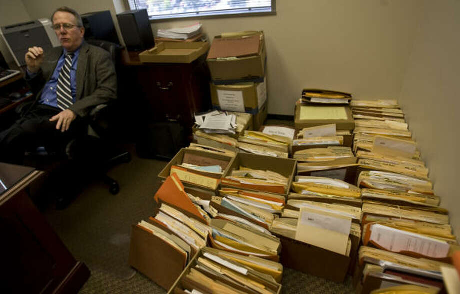 The dusty case files crowding Assistant District Attorney Russell Turbeville's office are being entered in a searchable computer database in order to find and arrest hundreds of Harris County fugitives who have fallen through the cracks since 1970. Photo: Karen Warren, Chronicle