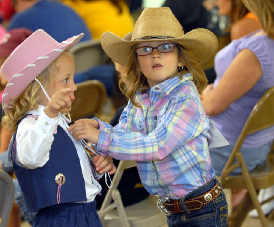 COWGIRLS BEING COWGIRLS: Karsyn Foster and Kaylee Dahlquist play after competing in the 4-7 Junior Princess competition at the 2008 Baytown Youth Fair and Rodeo Photo: Kim Christensen, For The Chronicle