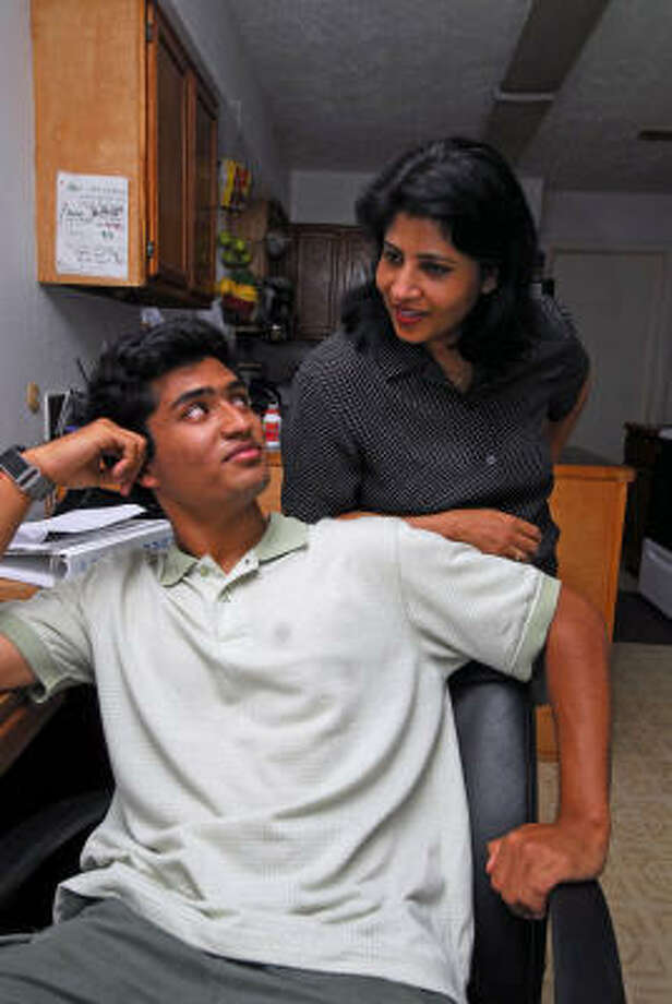 TONY BULLARD: For the Chronicle STAR STUDENT: Cy-Creek student Tapash Jay Sarkar vists with his mother, Tapati Sarkar, at their home. In his free time, Tapash enjoys playing tennis, piano and going to the movies with friends. Photo: Tony Bullard, ALL