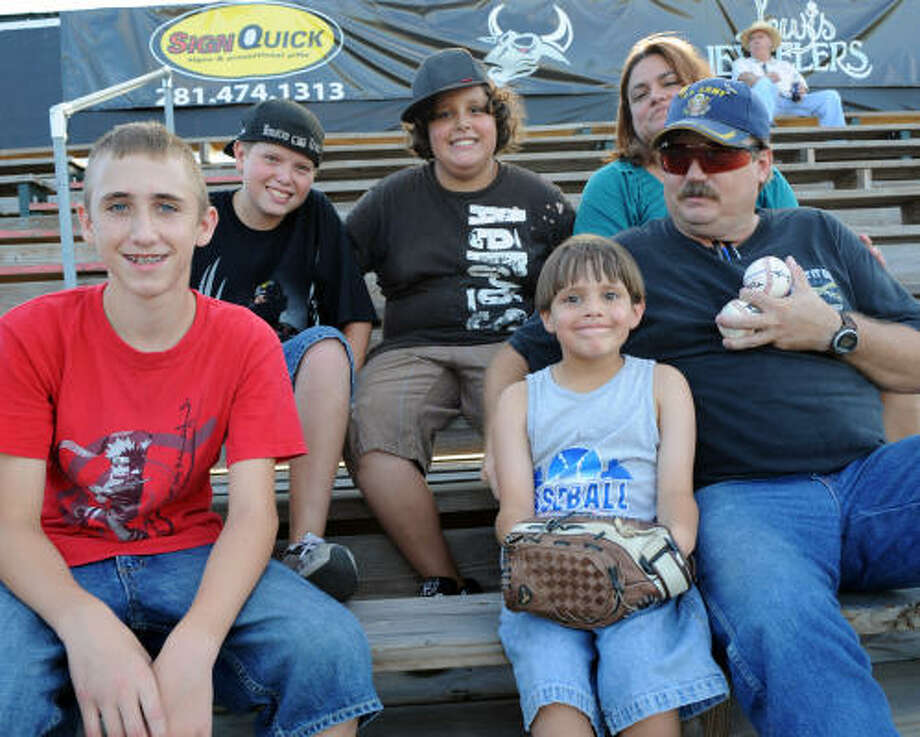IN THE STANDS: Toro fans Cameron Ingram, 12, front left, Shawn McCurdy, 6, Robert McCurdy, Logan McCurdy, 12, back left, Doug Walter, 12 and Kim McCurdy attend a home game. Photo: Kim Christensen, For The Chronicle