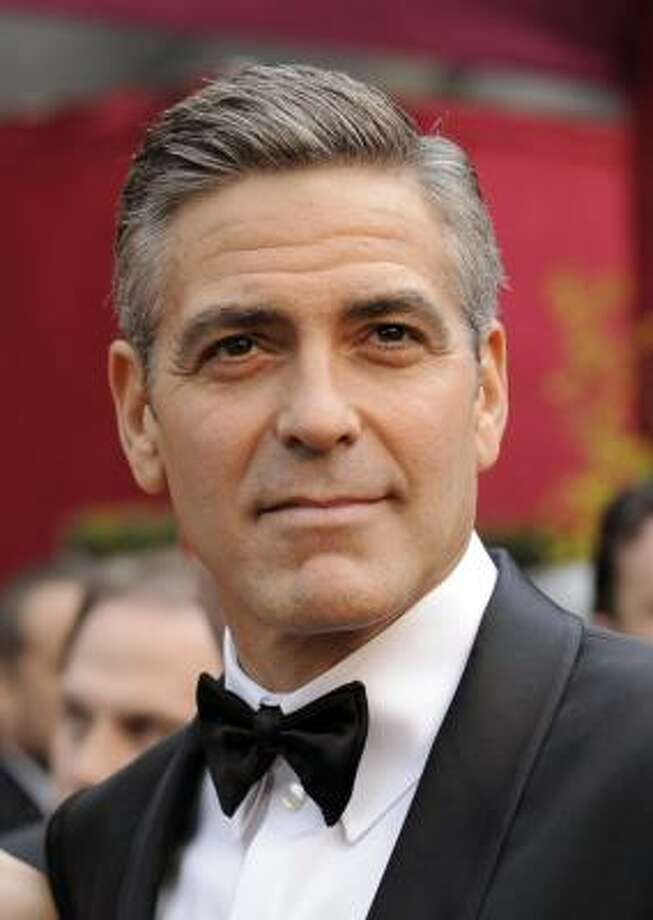 "** FILE ** In this Feb. 24, 2008 picture, George Clooney arrives for the 80th Academy Awards in Los Angeles. Clooney said Friday, Feb. 20, 2009 he has been visiting Darfur refugee camps in Chad near the Sudanese border and heard many violence-stricken Darfurians echo the same message: ""Bring us justice."" (AP Photo/Kevork Djansezian, file) Photo: Kevork Djansezian, AP"