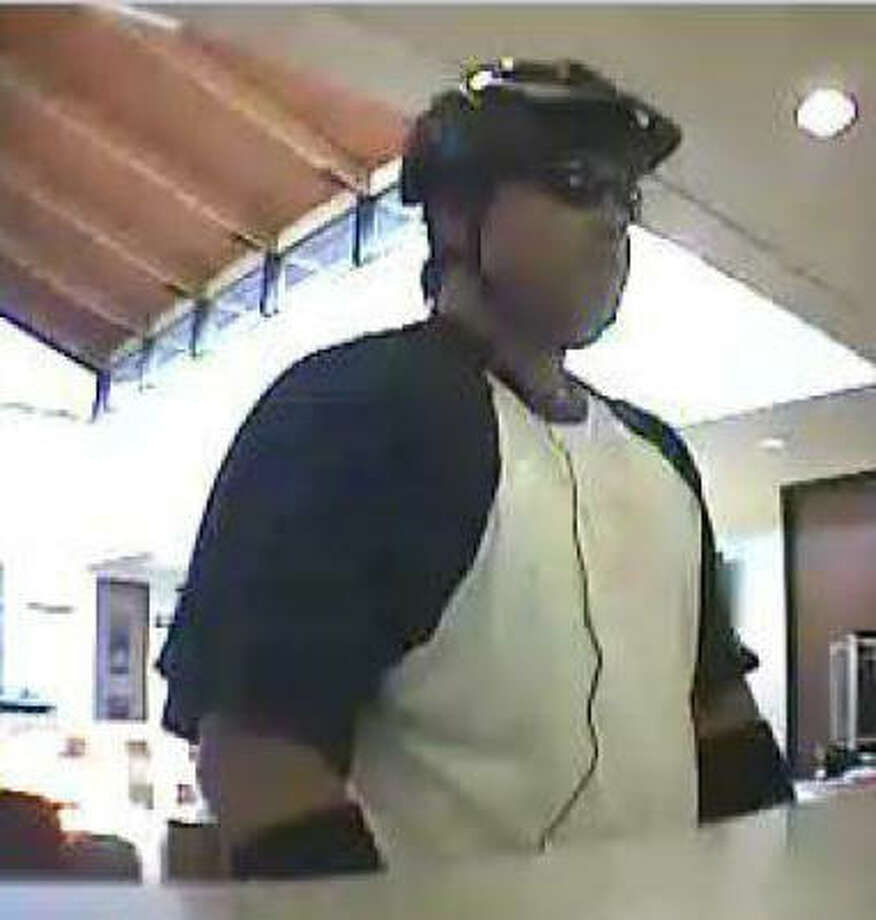 """A surveillance photo shows the suspect called the """"Reckless Robber,"""" who donned a dark-colored bicycle helmet. Photo: FBI"""
