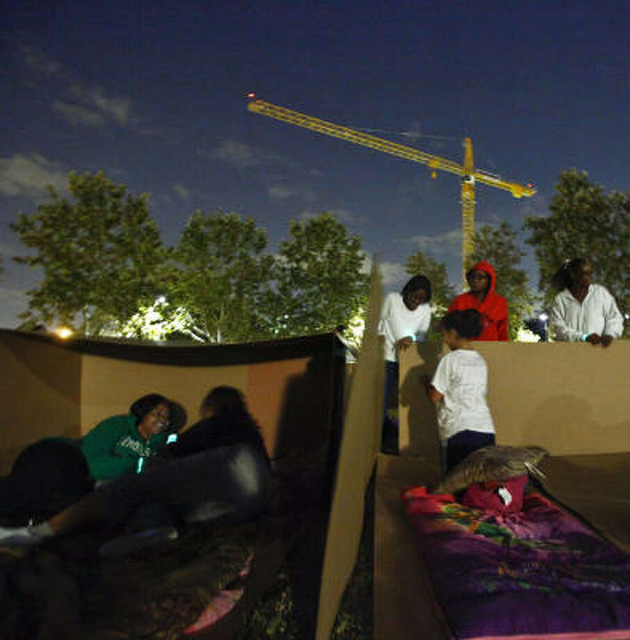 Nimitz High School students build cardboard shelters Saturday at Sesquicentennial Park downtown.  Photo: Michael Paulsen, Chronicle