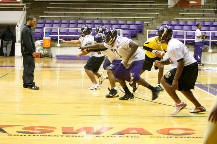The rain outside wasn't about to keep Prairie View A&M's offensive linemen from running drills on campus Tuesday in preparation for Saturday's SWAC Championship Game. Photo: Julio Cortez, Chronicle