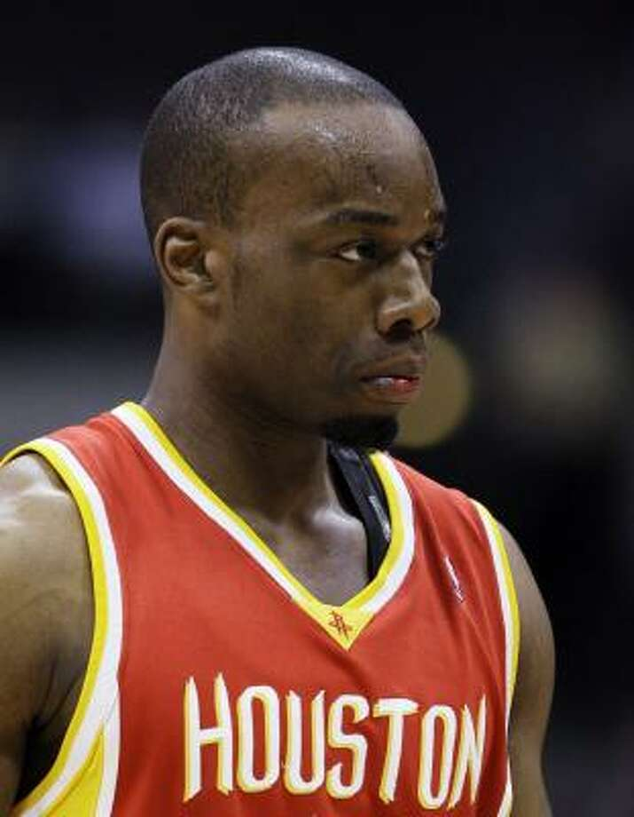 Rockets forward Carl Landry endured six hours of surgery to repair his teeth after a collision with Mavericks forward Dirk Nowitzki. Photo: Tony Gutierrez, AP