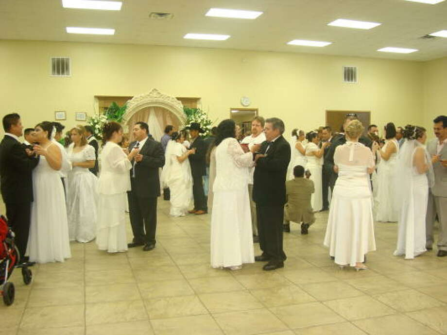 BIG CELEBRATION: Fifty-five couples were married Dec. 20 in a free mass wedding ceremony at Pasadena's St. Juan Diego Catholic Church.