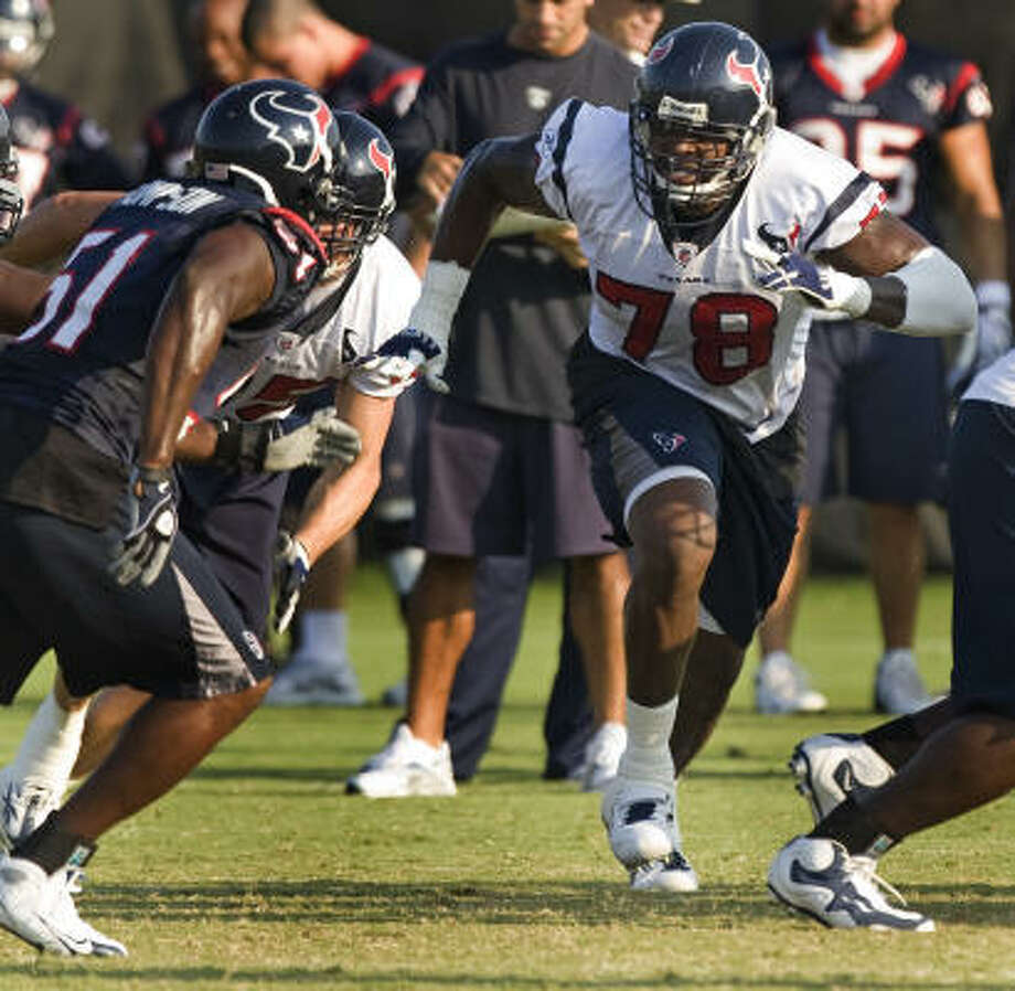 Texans tackle Rashad Butler (78) comes off the line to run block during a training camp workout Thursday. Photo: Brett Coomer, Chronicle