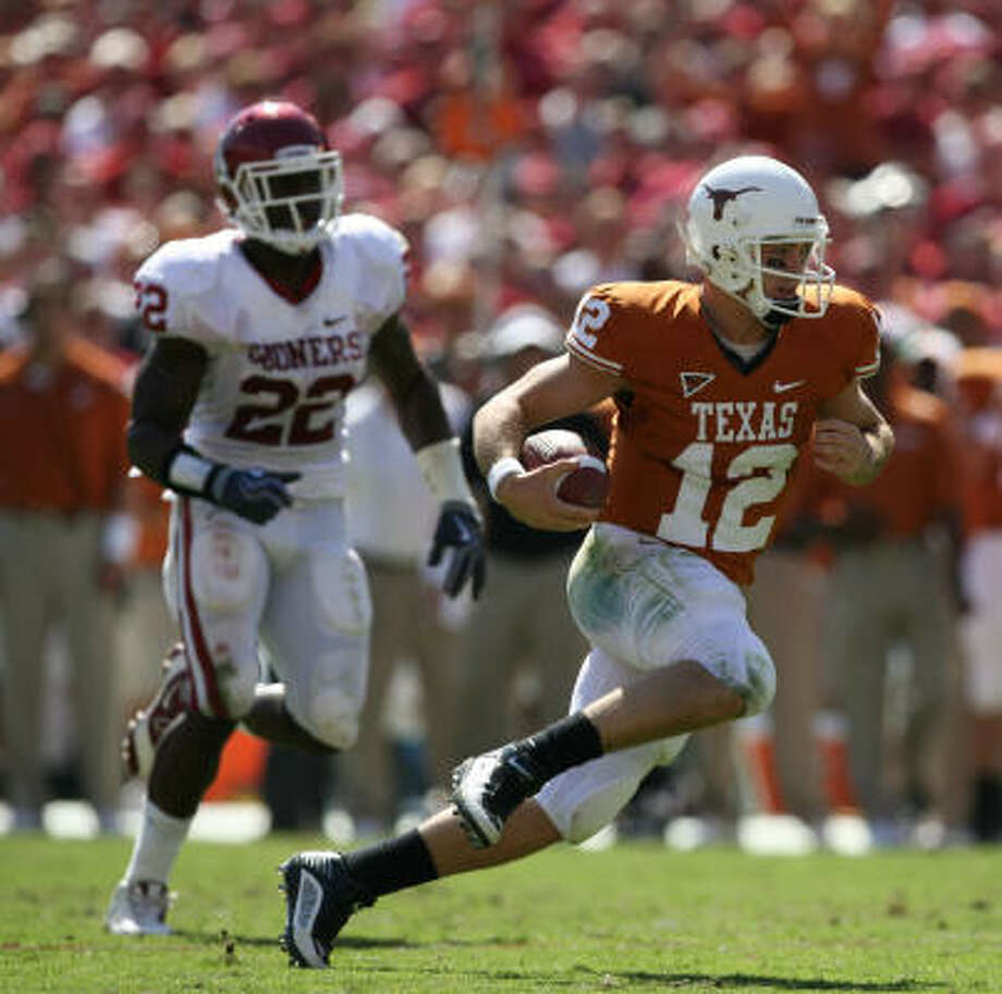 Texas quarterback Colt McCoy ran 14 times for 33 yards against Oklahoma. Photo: Billy Smith II, Houston Chronicle