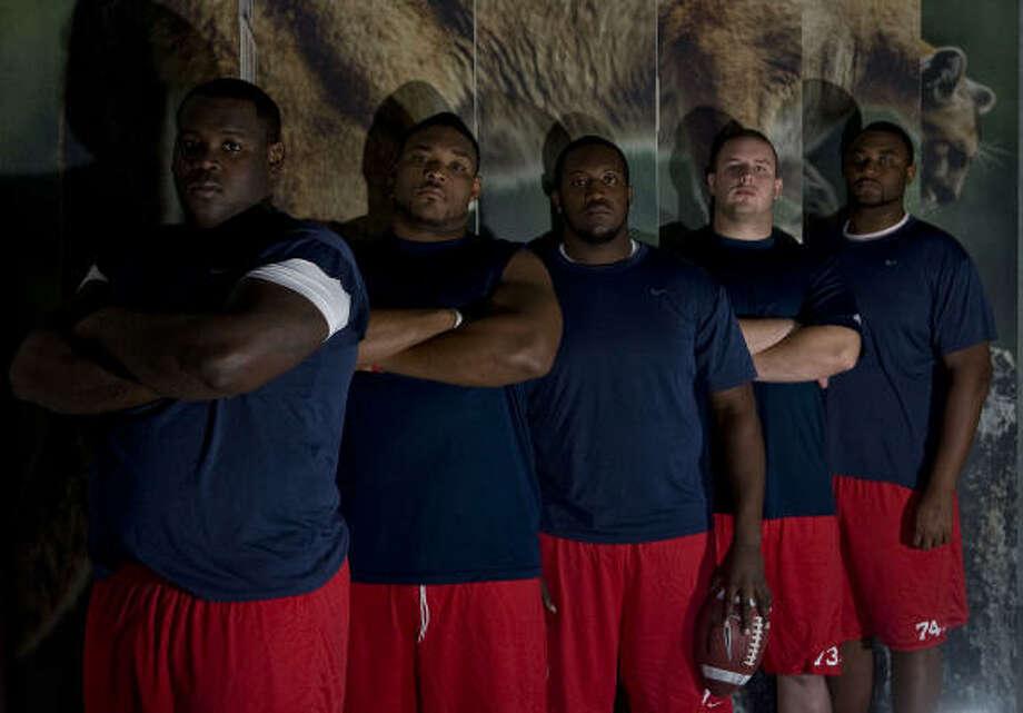 The UH offensive line, from left: Jarve Dean, Chris Thompson, Carl Barnett, Jordan Shoemaker and Roy Watts. Photo: James Nielsen, Chronicle