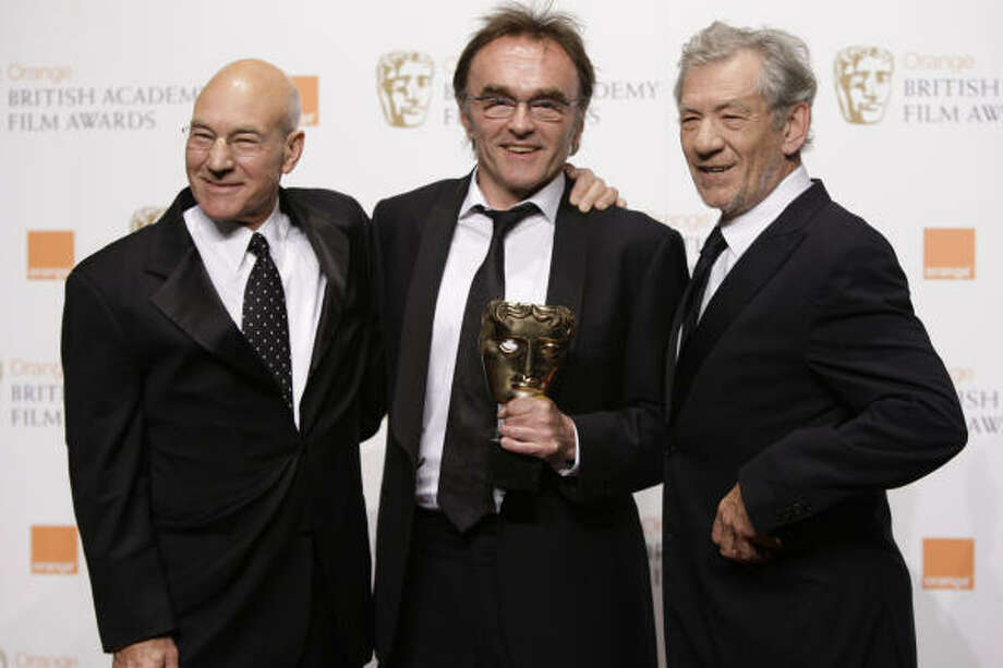 """British director Danny Boyle, center, displays his award for Best Director for the film """"Slumdog Millionaire,"""" with actors Patrick Stewart, left, and Sir Ian McKellen on Sunday at the British Academy Film Awards in London. Photo: Joel Ryan, Associated Press"""