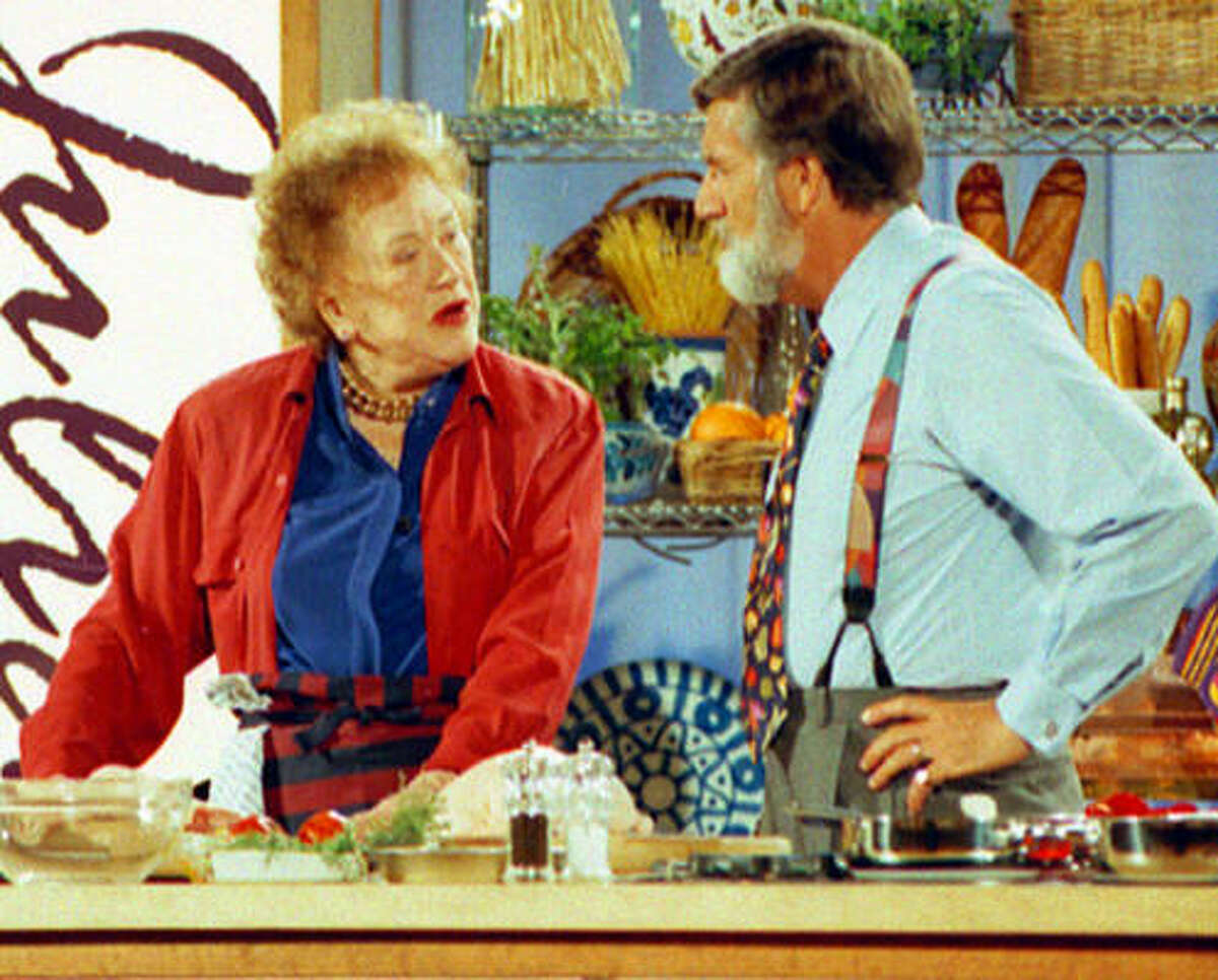 Julia Child and Graham Kerr tape a cooking show for PBS during an international food convention in San Antonio in 1995.