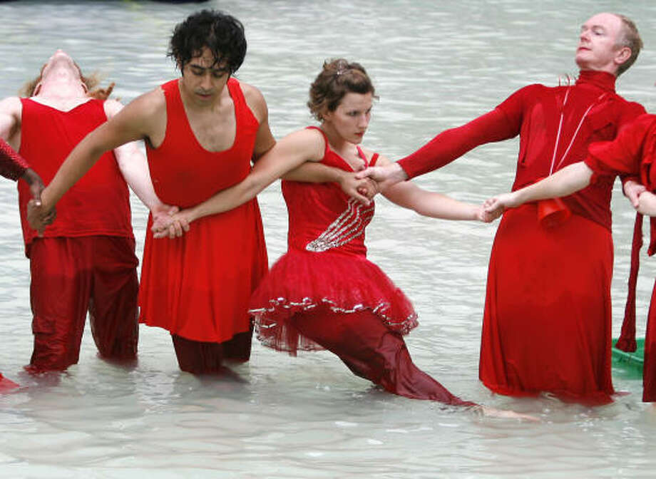 Dancers with Core Performance Company — Corian Ellisor, left, Blake Dalton, Alex Abarca, Mary Jane Pennington, D. Patton White and Claire Molla — dance in the City Hall fountain during a modern dance routine at the 13th Annual Bayou City Art Festival Downtown. Photo: Karen Warren, Chronicle