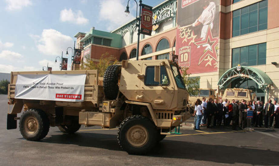 One of the Army's armored tactical vehicles, built in Sealy, was at Minute Maid Park Monday. Officials said that losing the contract to build the trucks would cost the Houston area an estimated $1.8 billion, or seven Minute Maid Parks, per year. Photo: Gary Fountain:, For The Chronicle