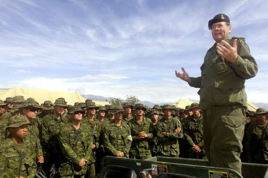 LOU PENNEY : CANADIAN DEPARTMENT OF NATIONAL DEFENCE   ASSOCIATED PRESS CONTROVERSY: Canadian soldiers form one of the largest contingents of troops in Afghanistan, and they're taking flak for turning prisoners over to the unsure custody of the Afghans. Photo: CPL LOU PENNEY, CP