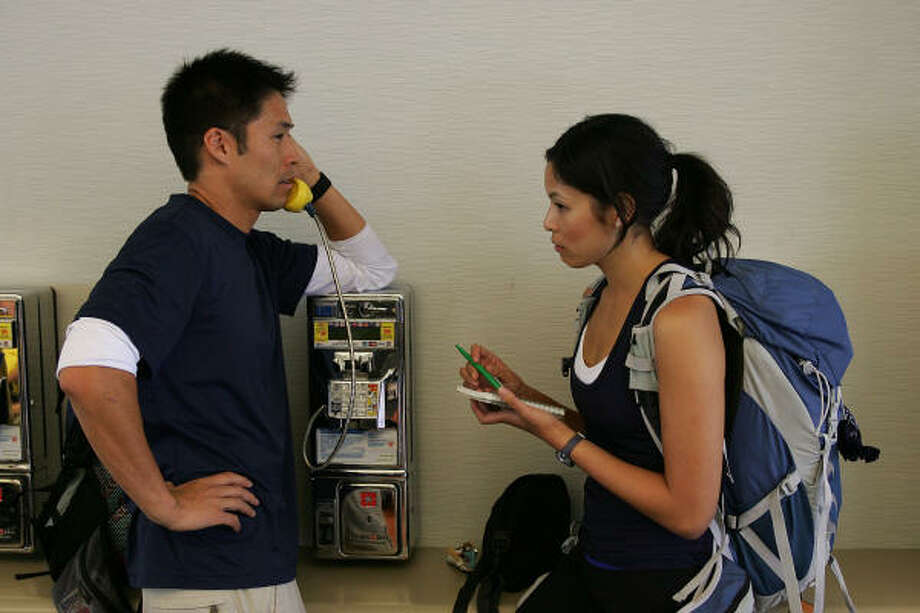 ASIAN-AMERICAN TEAM: Brother-and-sister team Victor and Tammy make a few calls before boarding a plane at LAX departing for their first destination, on The Amazing Race on CBS. Photo: ROBERT VOETS, CBS