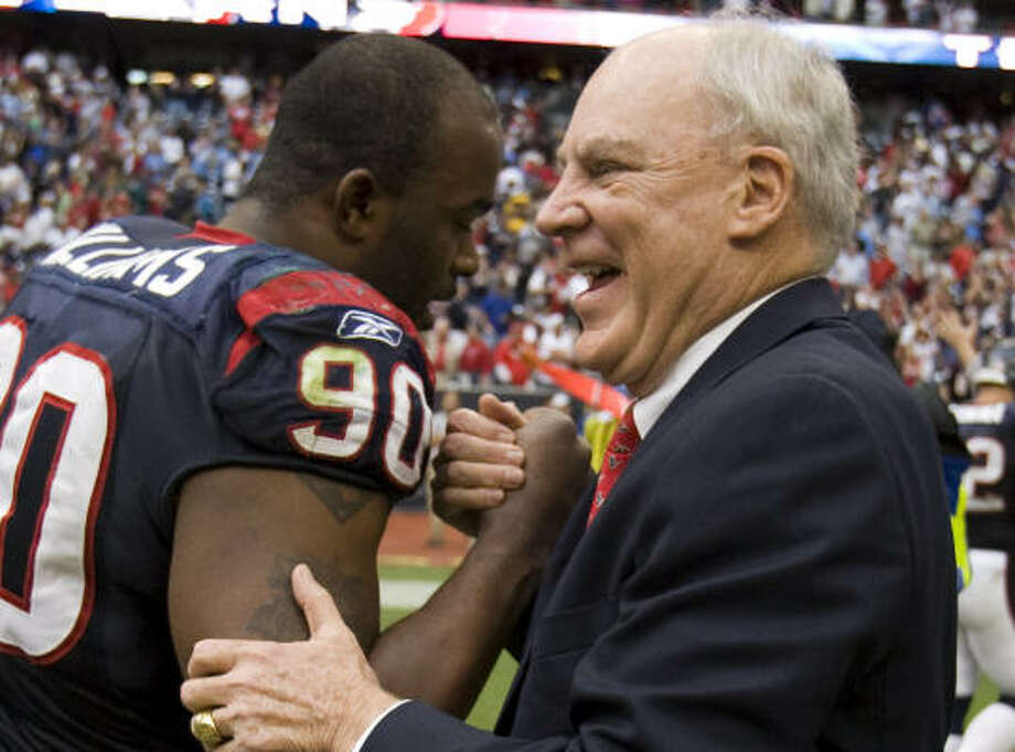 Texans owner Bob McNair, right, hopes Mario Williams and Co. can build on their 6-1 finish this past season. Photo: Brett Coomer, Houston Chronicle
