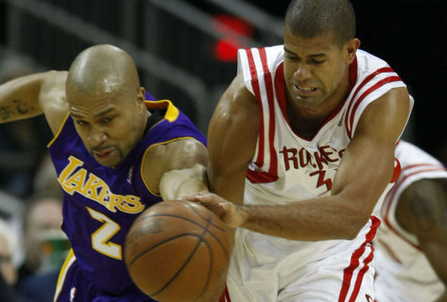 Shane Battier, right, believes defense will keep the Rockets in their series against Derek Fisher and the Lakers. Photo: Julio Cortez, Chronicle