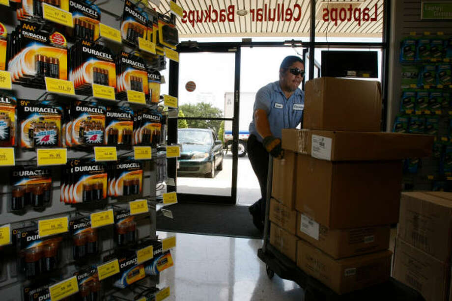 Salvador Guevara delivers supplies to the Batteries Plus store on Gessner in Houston. The Wisconsin-based company says it has more than 350 stores nationwide and sells more than a million batteries a week. Photo: Julio Cortez, Chronicle