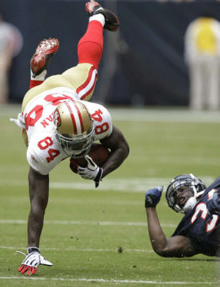 Texans safety Bernard Pollard (31) sends 49ers receiver Josh Morgan head over heels on a first-half tackle Sunday at Reliant Stadium. Photo: Brett Coomer, Chronicle