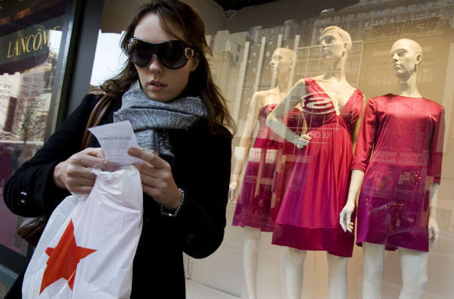 A shopper checks her receipt outside Macy's in New York in 2008, during economically happier times. It may have been a happier time for returning items, too. Photo: MARK LENNIHAN, ASSOCIATED PRESS