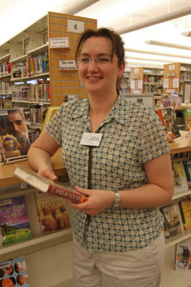 Angel Hill of Cypress is the new librarian at the Katy Library at 5414 Franz Road. Photo: Suzanne Rehak, For The Chronicle