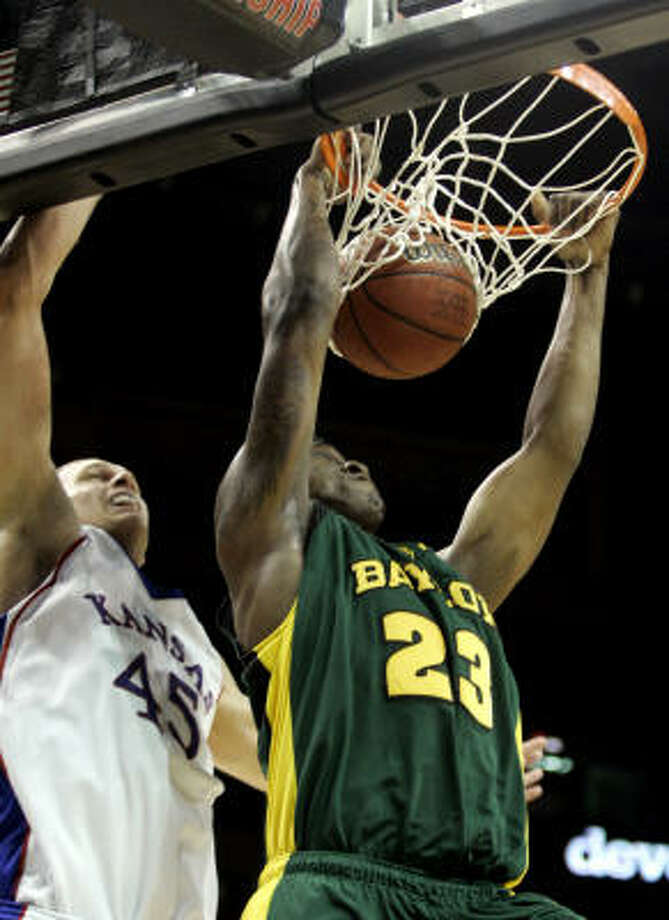 Baylor's Kevin Rogers dunks the ball in front of Kansas' Cole Aldrich. Photo: Donna McWilliam, AP