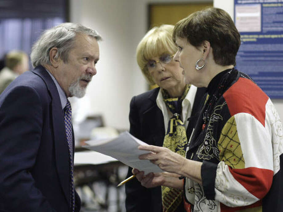 Board of Education members Geraldine Miller (center) and Patricia Hardy confer during this week's meeting in Austin. With them is Ronald Wetherington, a science adviser to the panel. Photo: Harry Cabluck, AP