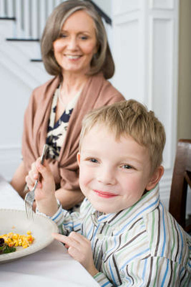 To avoid potential holiday eating faux pas, parents should let little ones know what's expected of them ahead of time. Photo: Fotolia