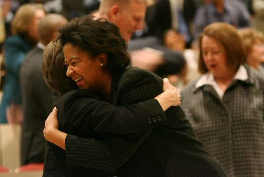 Civil District Judges Sharon McCally, left, and Alexandra Smoots-Hogan embrace after a brief swearing-in ceremony. Photo: MAYRA BELTRAN, CHRONICLE