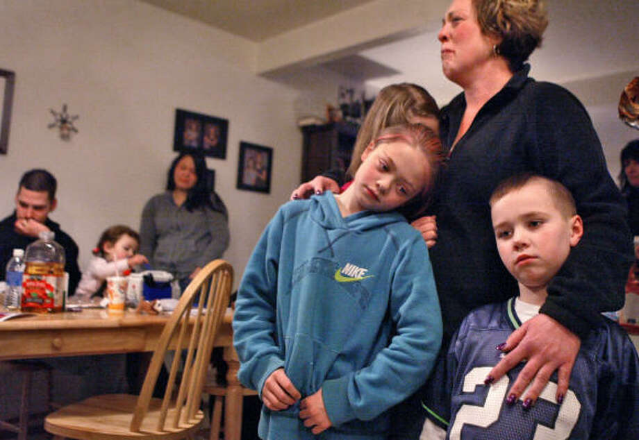 Phyllis Dwyer fights back tears while comforting her children Gabriel, 7, Morgan, 9, and Marissa, 10, Saturday, Jan. 17, 2009 at their home in Puyallup, Wash. Debris flew into the grandstands at a monster truck show in Washington state, killing a 6-year-old boy and injuring another spectator, witnesses and city officials said Saturday. Photo: DREW PERINE, AP