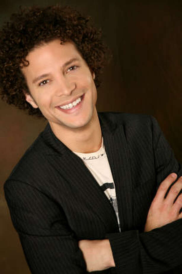 American Idol runner-up Justin Guarini says he owns a copy of From Justin to Kelly, the ill-fated musical that cast him alongside winner Kelly Clarkson, but he hasn't watched it in years. Guarini now reports on Idol for the TV Guide Channel and will pop up as a potential twanger on the CMT series Gone Country. Photo: Tony Phipps