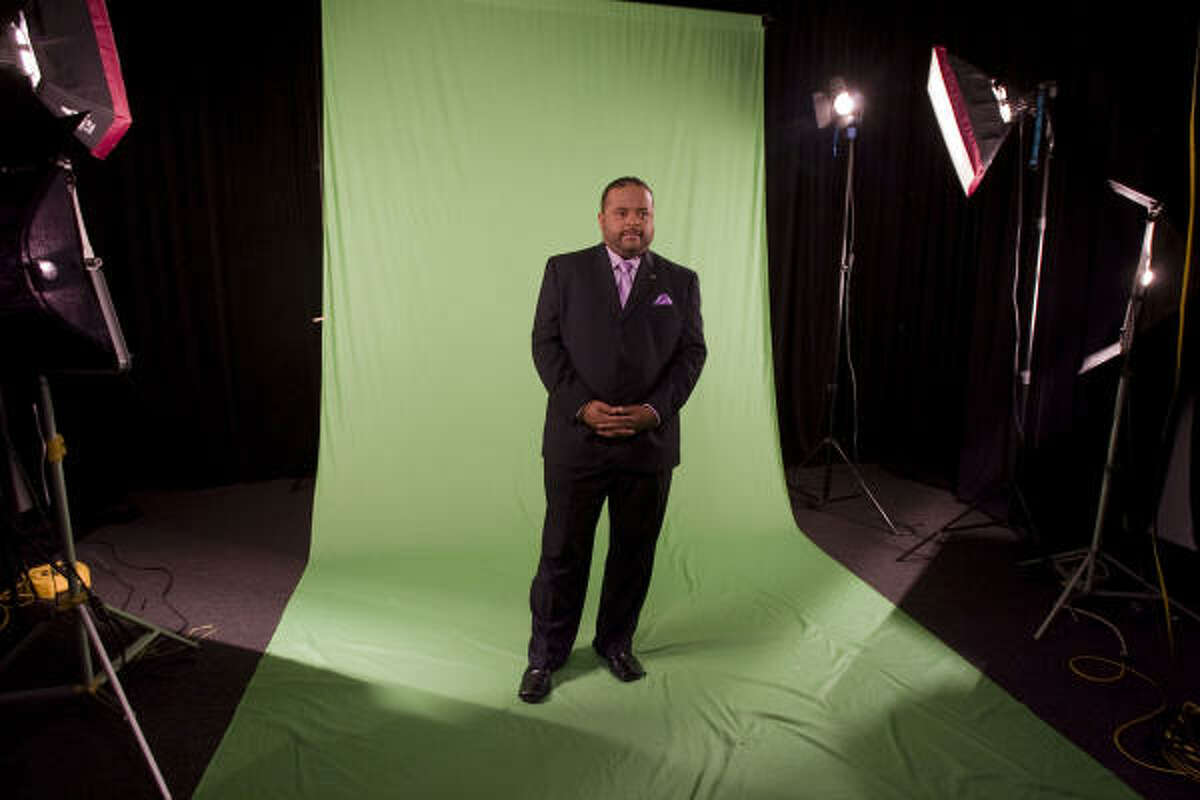 CNN analyst and multimedia journalist Roland Martin stops long enough for a photo session while in Houston.