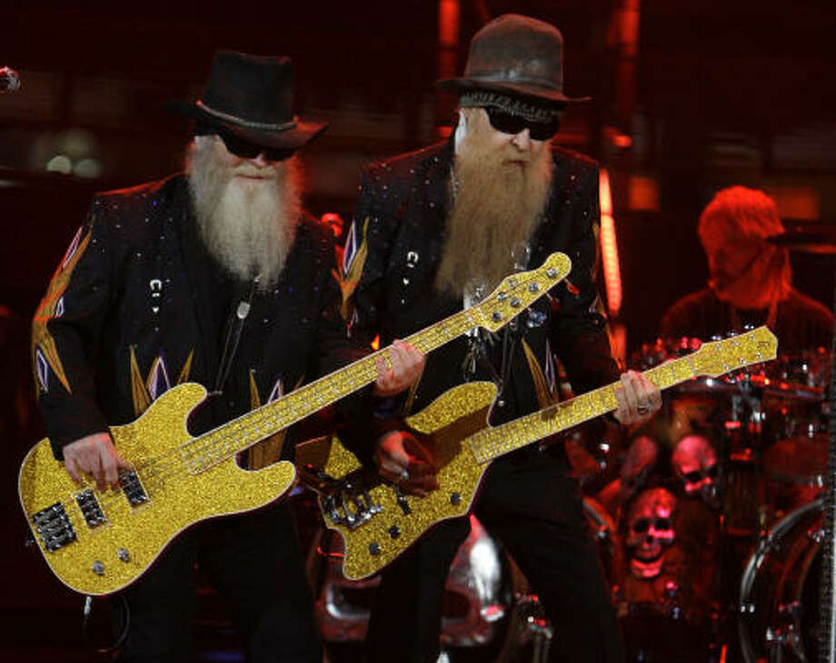 In their fourth rodeo appearance, ZZ Top's Dusty Hill, left,  Billy Gibbons and Frank Beard had the audience at this season's final show cheering and singing along. Photo: Melissa Phillip, Chronicle