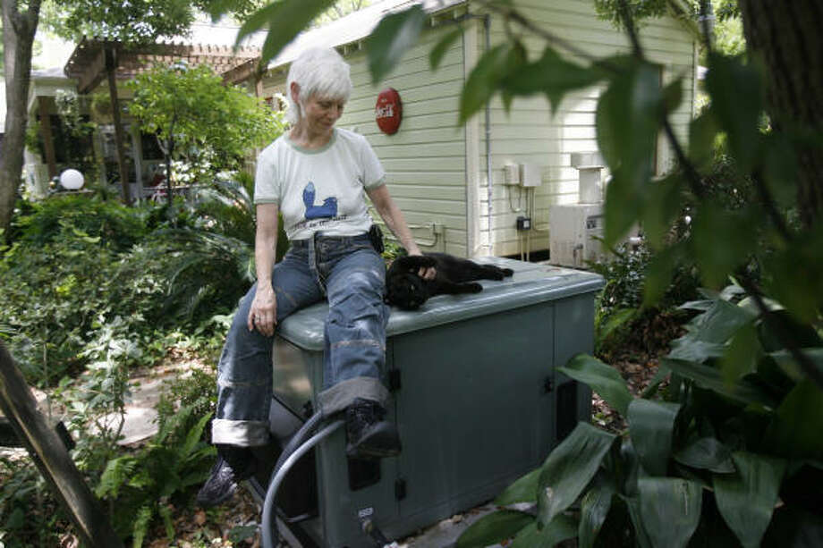 Sharon Carter bought a $10,000 natural gas backup generator for her Heights home shortly after Hurricane Ike left her without power for eight days. The generator can keep everything electrical in her house operating. Photo: MAYRA BELTRAN :, CHRONICLE