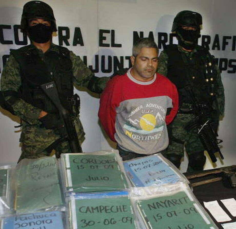 Suspected Zeta cartel hit man Carlos Adrian Martinez is presented to the media Wednesday in Monterrey. Photo: JUAN CARLOS REYES, AFP/Getty Images