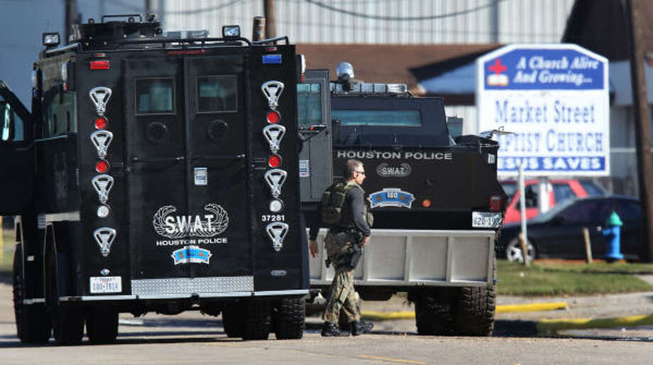 Houston police SWAT officers work the scene at Market Street Baptist Church in Houston on Saturday. Photo: Smiley N. Pool, Chronicle