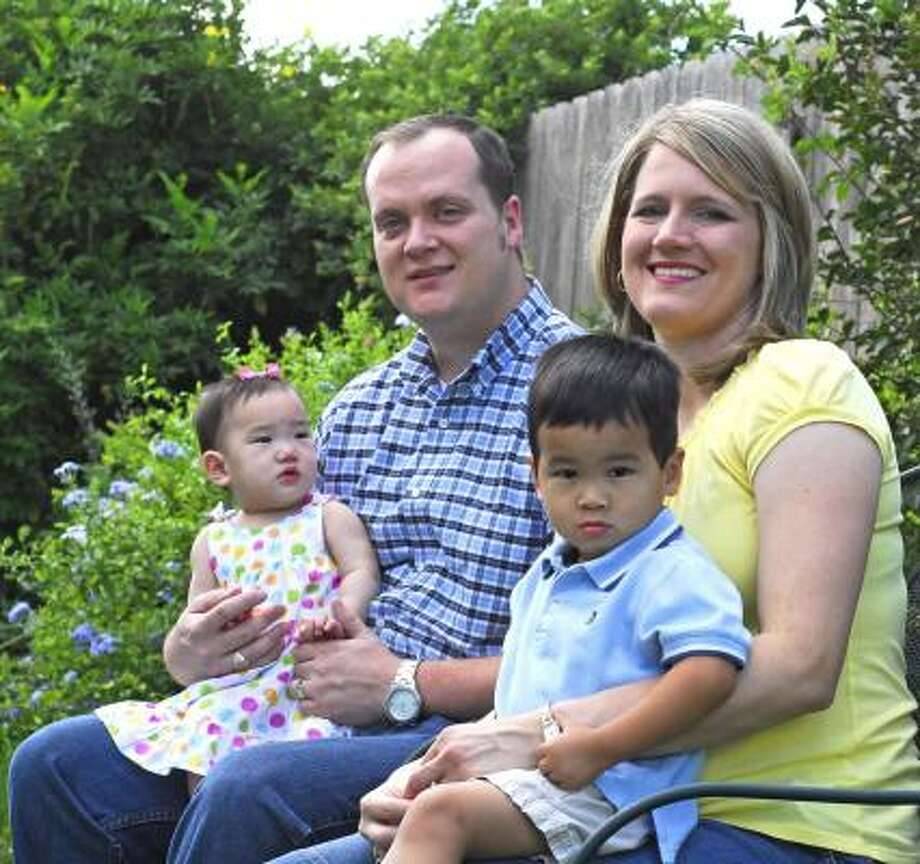 Dan and Elisabeth Brodt with their children Emma, 9 months, and Noah, 2 years, at their Katy home. Photo: Tony Bullard, For The Chronicle