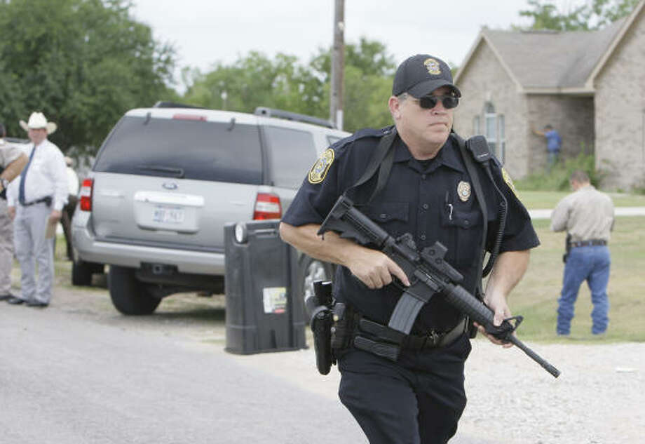 Police are on the scene on the northern edge of Brookshire Wednesday near the home of Katy Independent School District officer Rachel Hillsman. Photo: Melissa Phillip, Chronicle