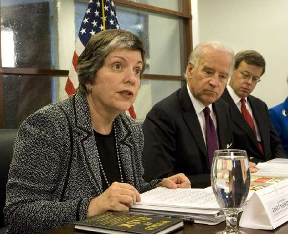 Homeland Security Secretary-designate Arizona Gov. Janet Napolitano, left, speaks as Vice President-elect Joe Biden, center, is briefed by Jim Talent, co-chair Commission on the Prevention of WMD Proliferation and Terrorism, right, at the presidential transition headquarters in Washington last month. Photo: J. Scott Applewhite, AP