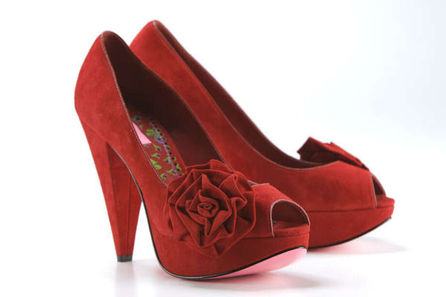 Betsey Johnson red suede pumps, $129.95, are available at DSW. Photo: Brett Coomer, Chronicle