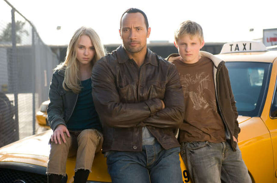 AnnaSophia Robb, from left, Dwayne Johnson and Alexander Ludwig star in Disney's kid-friendly comedy, Race to Witch Mountain. Photo: MCT