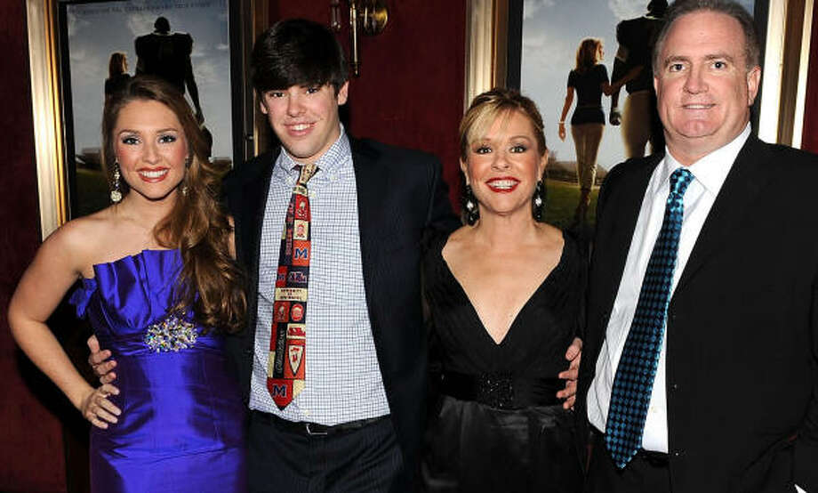 """The Tuohys: Collins, from left, Sean Jr., Leigh Anne and Sean Tuohy attended the premiere of """"The Blind Side"""" in New York last month. Photo: STEPHEN LOVEKIN:, GETTY IMAGES"""