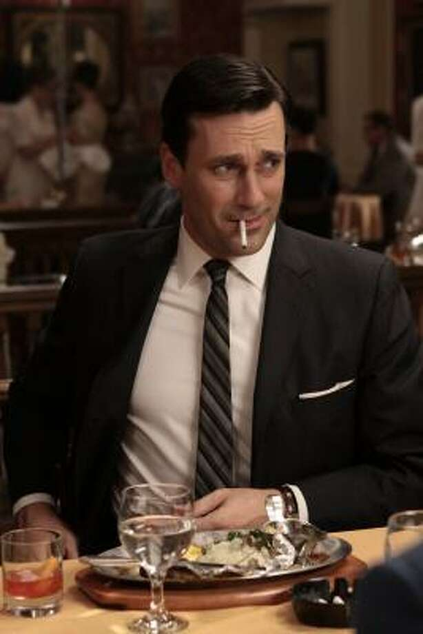 Don Draper, portrayed by Jon Hamm, has experienced existential crises, a difficult marriage and other upheavals in the AMC series Mad Men. Photo: AMC