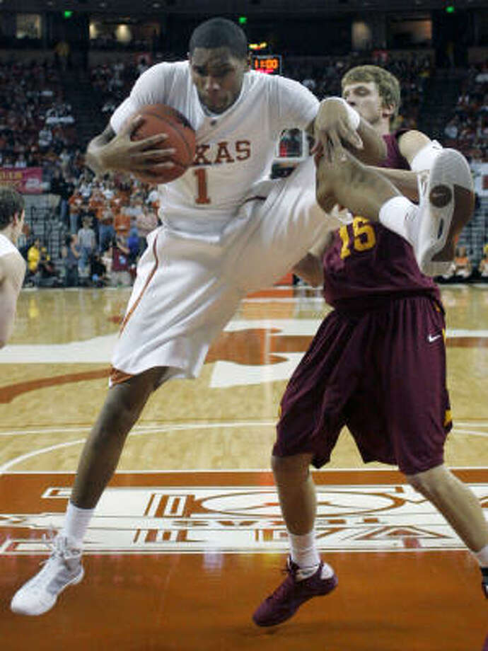 Aldine product Gary Johnson secures a rebound against the visiting Cyclones. Photo: Harry Cabluck, AP